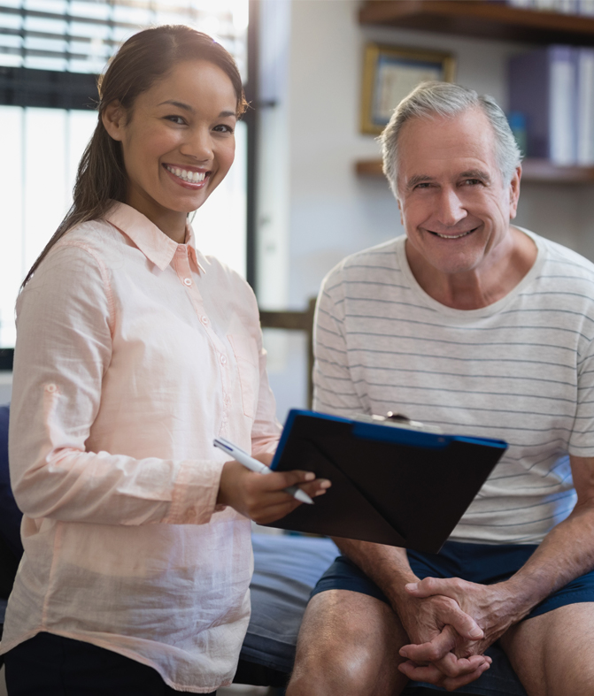 Picture of therapist working with client on physical goals